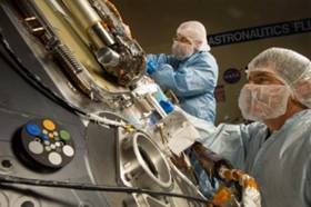 Scientists and engineers work on machinery in clean rooms to minimize contaminants from Earth.